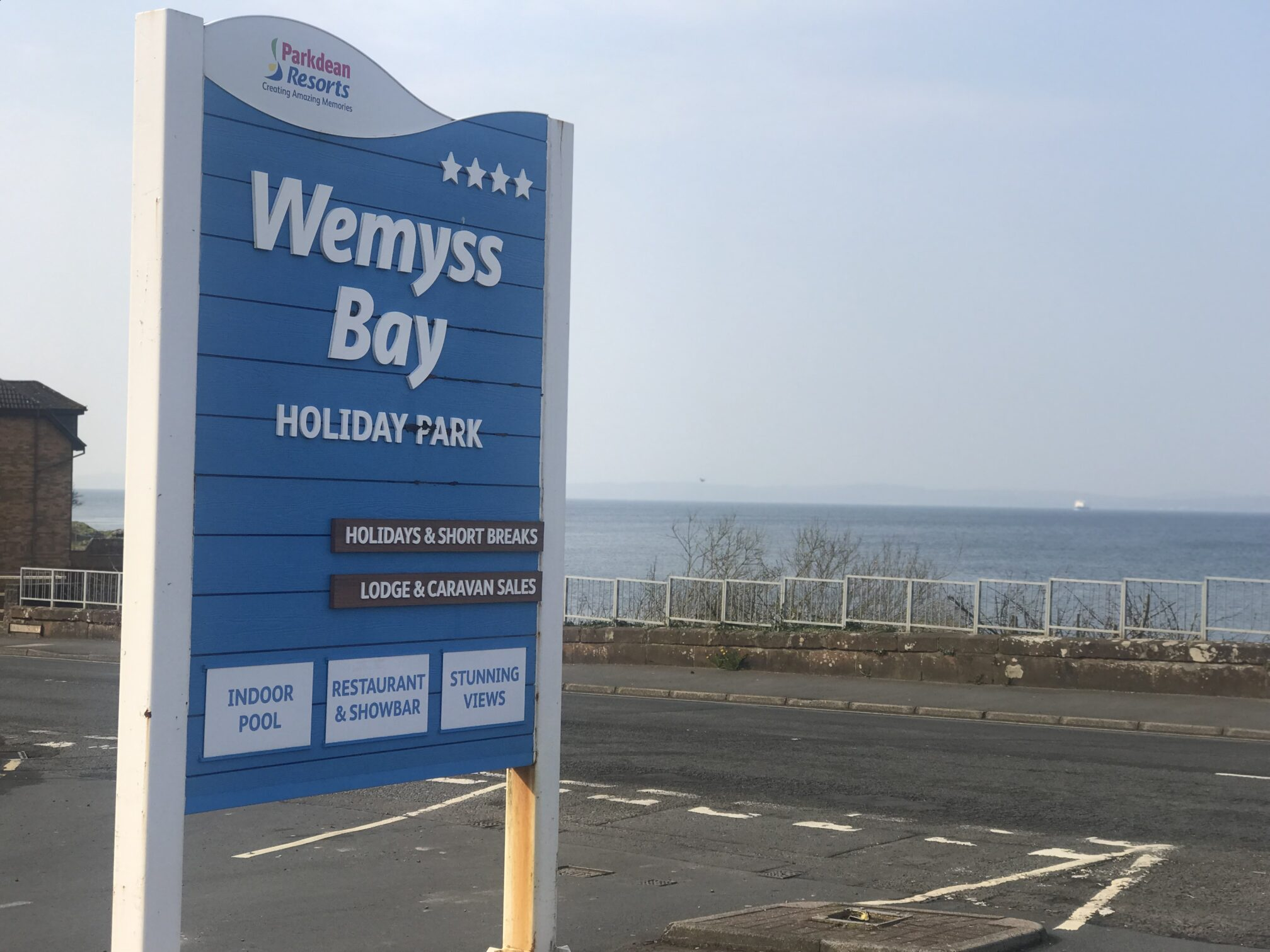 Wemyss Bay Holiday Park sign and the sea in the background