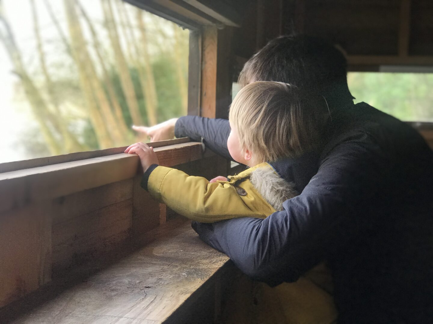 Neil and Dexter in a bird hide in Mere Sands Woods, West Lancashire