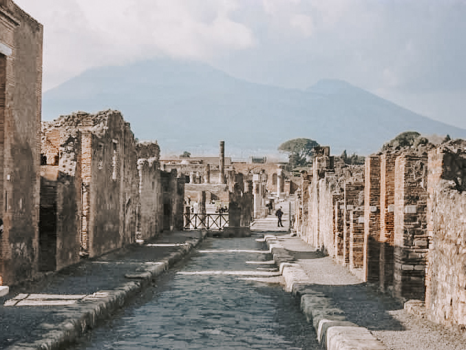 A street in Pompeii with Vesuvius in the background