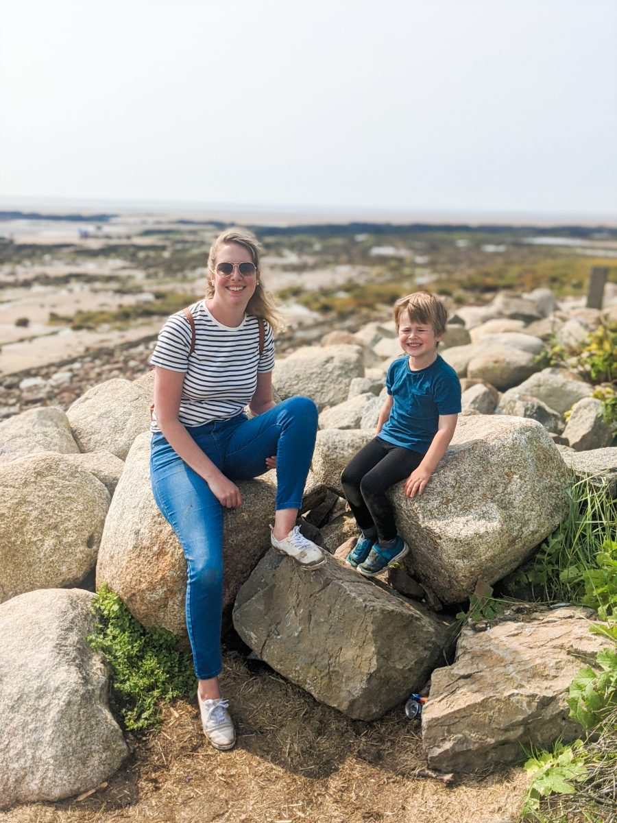 Nicola and Dexter posing on the rocks on Southerness beach