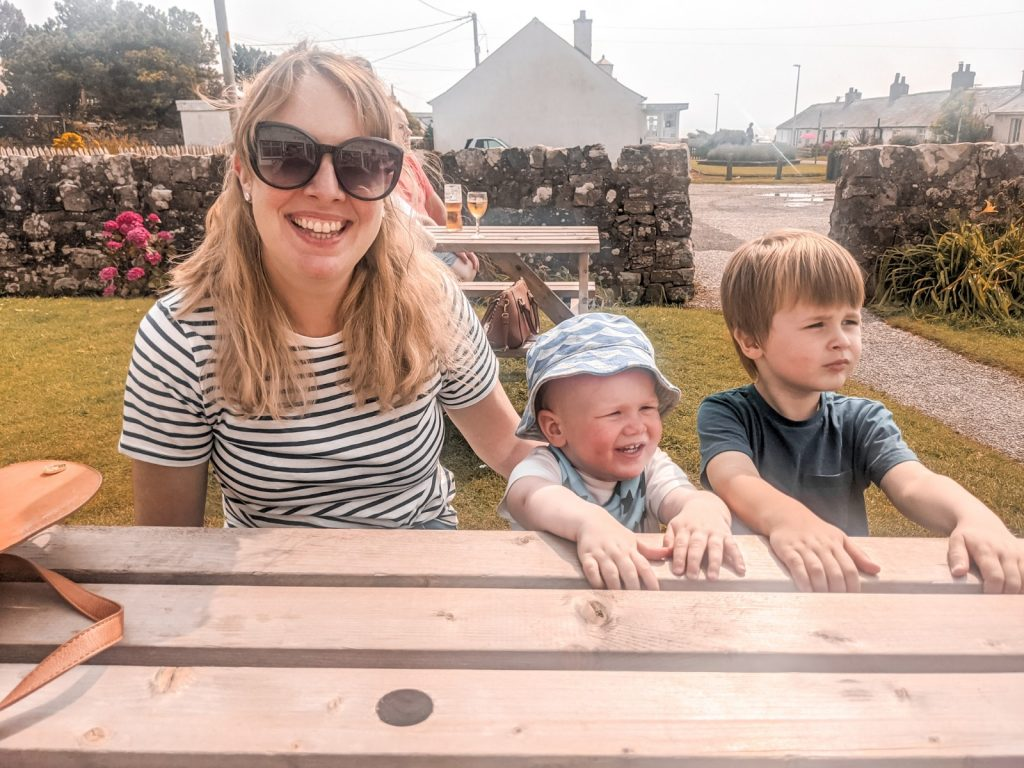 Nicola, Felix and Dexter sat outside John Paul Jones bar and grill in Southerness