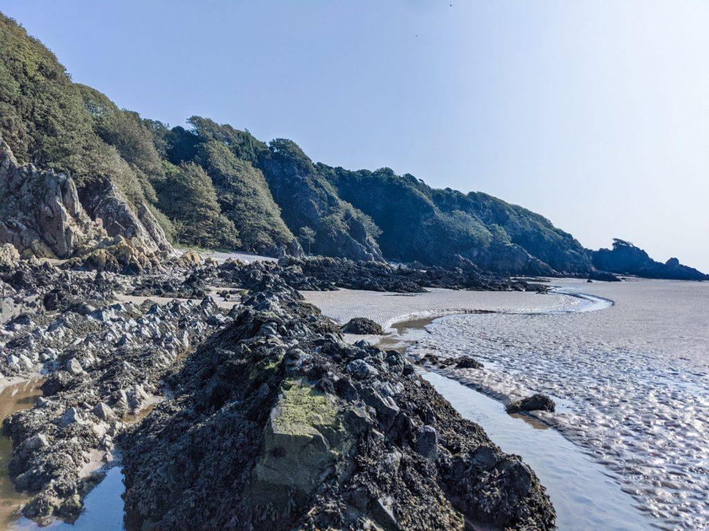 Sandyhills beach and rocky terrain